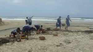 School children join local elders to clean up their backyard beaches